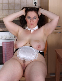 Big mature slut getting naughty in her kitchen