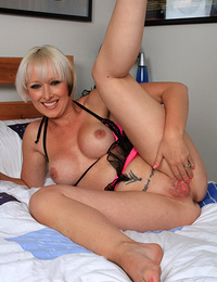 Nasty mature ho shows her firm tattooed buns