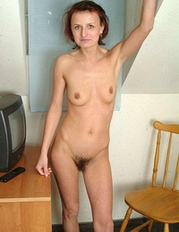 Slim MILf showing off her still-tight and very wet hole!