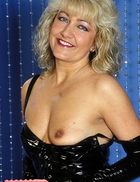 Mature Babe In Black Latex Exposes Her Boobies And Vagina